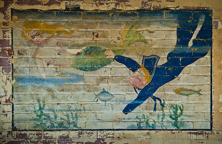 A mural depicting sailor and a mermaid