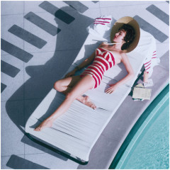 Austrian actress Mara Lane lounging by the pool